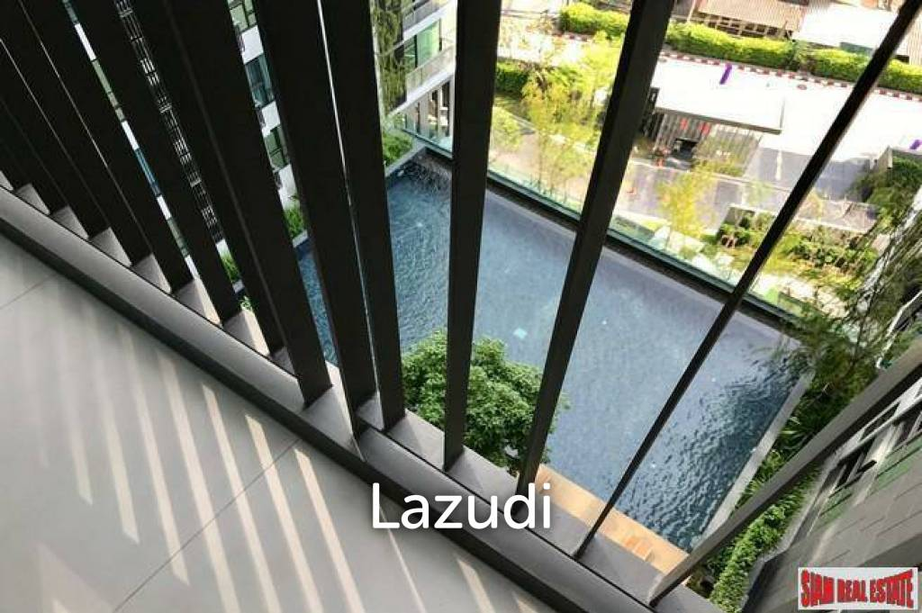 Rhythm Sukhumvit 36 | Comfortable One Bedroom Thong Lo Condo for Sale with City & Pool Views